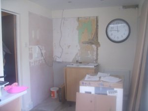 Photo of kitchen - with gas pipe exposed
